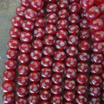 Indonesian Glass Maroon with Blue Dot 7mm
